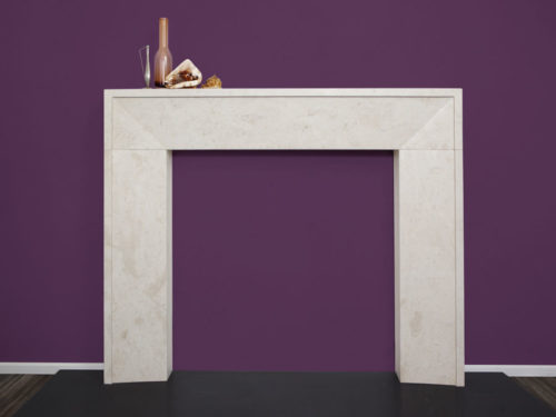 Contemporary minimalistic fireplace made of beige limestone