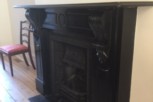 Antique lintel fireplace made of Belgium black marble