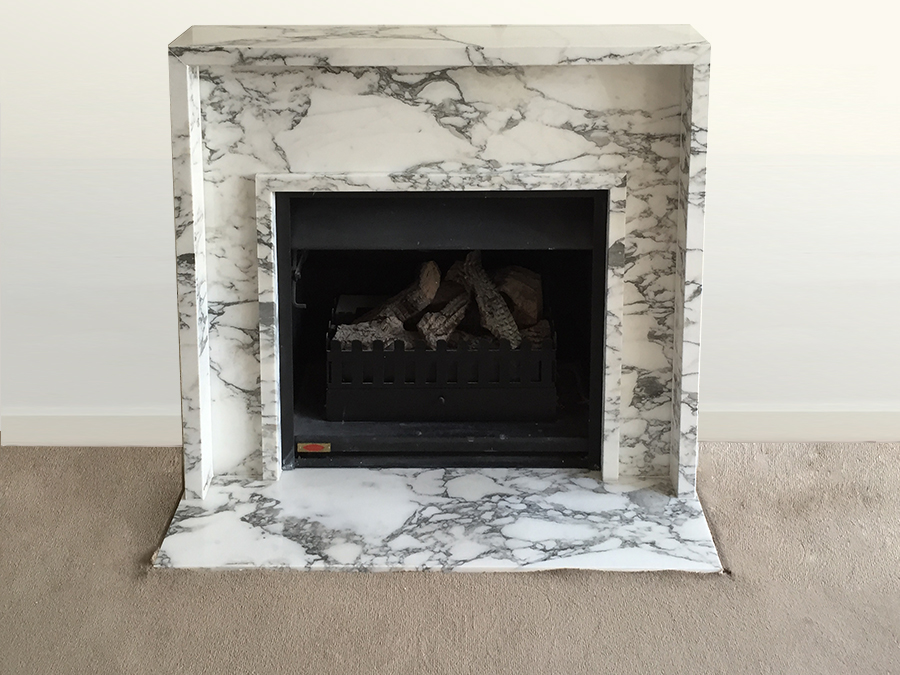 contemporary arabescato marble fireplace and a hearth
