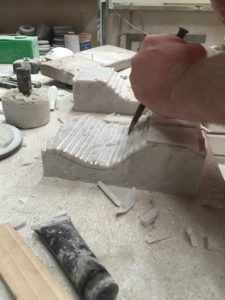 hand carving corbels for a fireplace