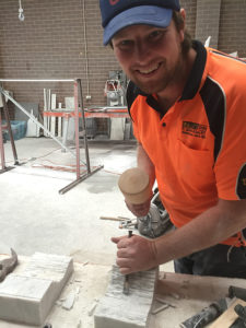 Jamie Hallett carving marble corbels for a fireplace