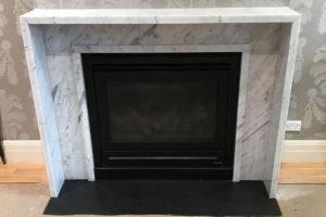 white Carrara marble modern fireplace