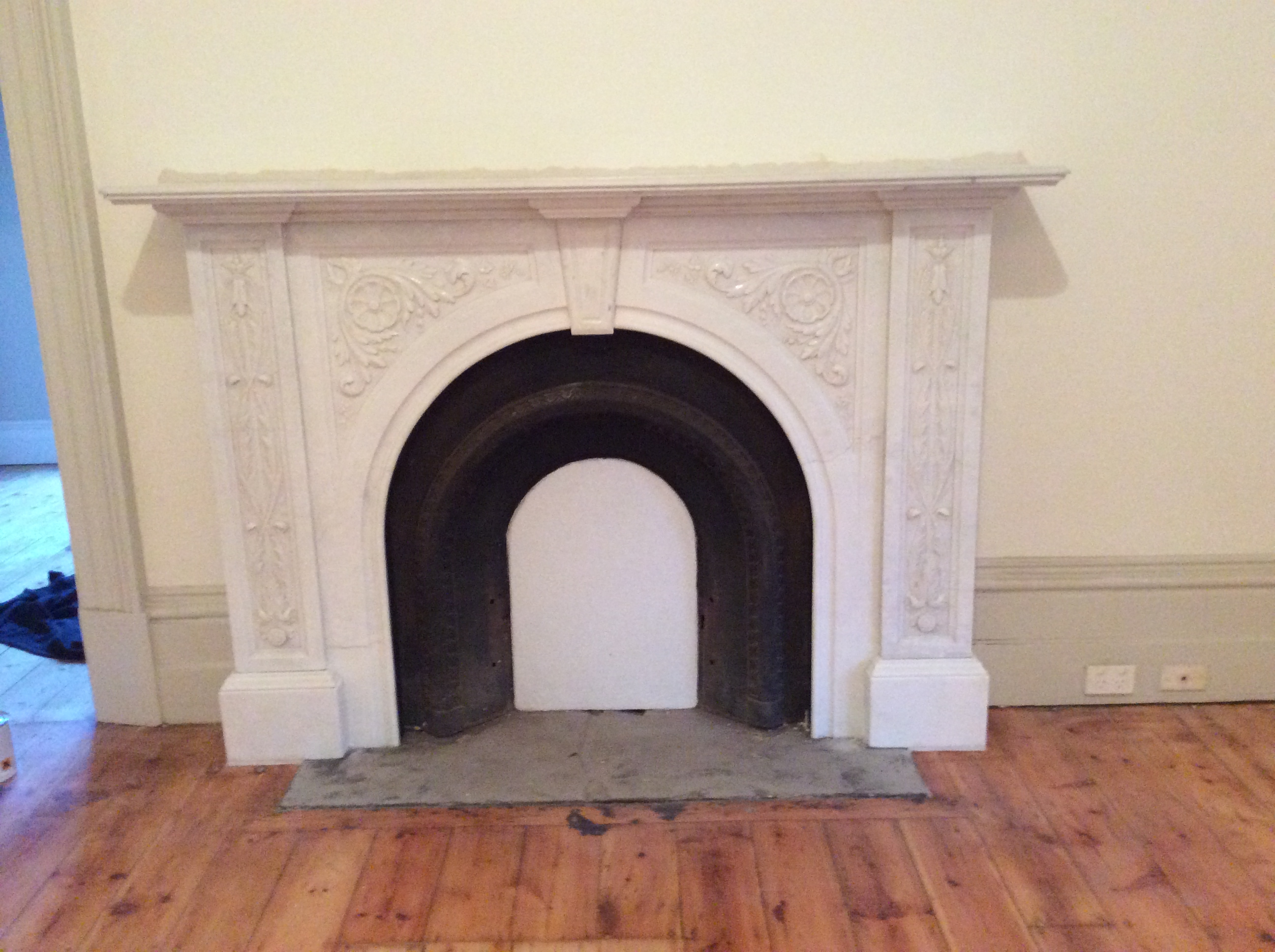 Victorian arched floral fireplace after restoration Victorian fireplace restoration