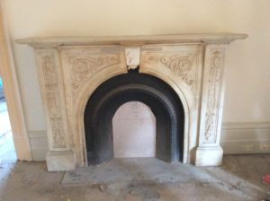 Victorian arched floral fireplace before restoration