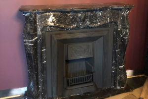 Nero Marquina marble French style fireplace
