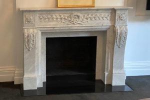 white carrara marble neoclassical fireplace