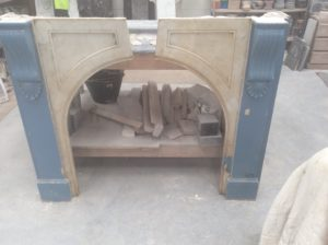 Victorian arched painted fireplace before restoration