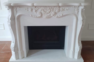 white marble French style fireplace