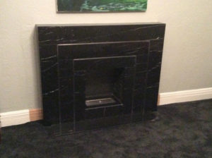 Art Deco custom made Black Marquina marble fireplace