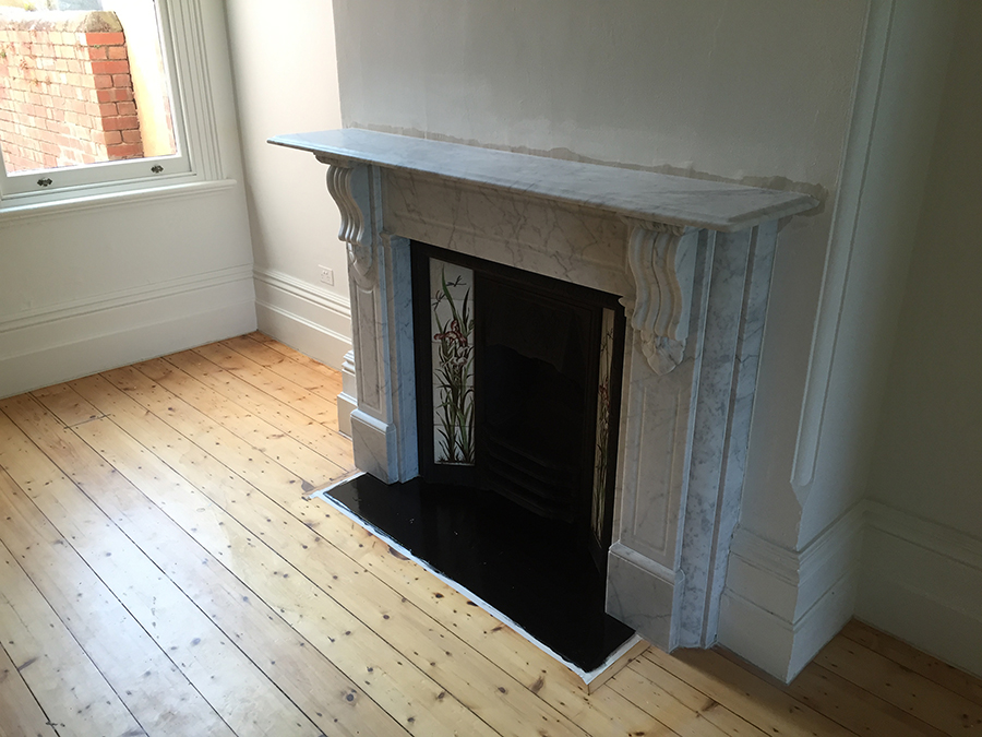Victorian fully restored antique lintel fireplace with corbels and drops made of Italian White Carrara with a granite hearth