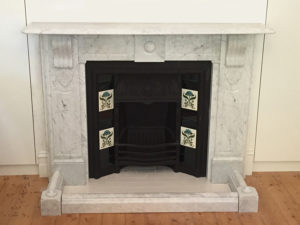 Victorian fully restored antique lintel fireplace with corbels and drops made of Italian White Carrara with a fender