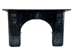Victorian style arched fireplace made of Black Maquina marble
