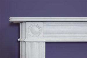 bull's eye design fireplace made of white marble