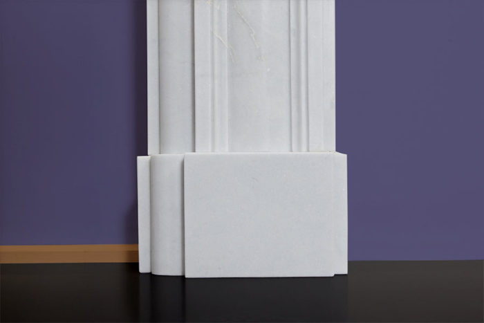 bull's eye design fireplace made of white marble