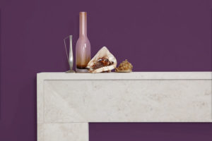 Contemporary minimalistic fireplace made of beige limestone
