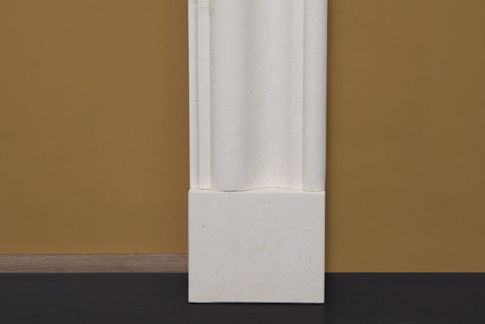 Contemporary style elegant fire surround made of limestone