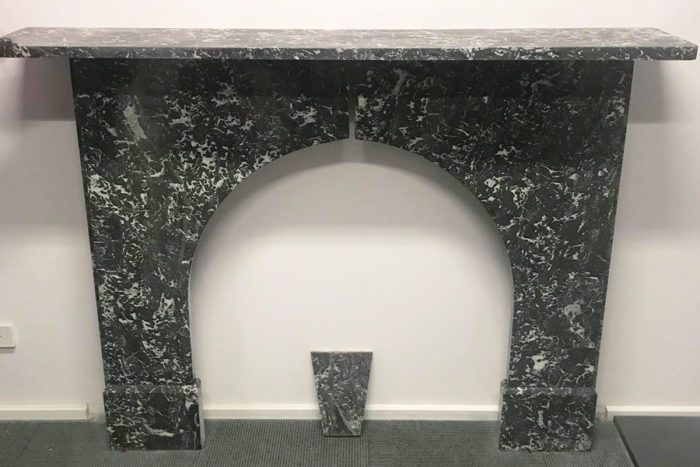 Antique arched fireplace made of St Anne's marble