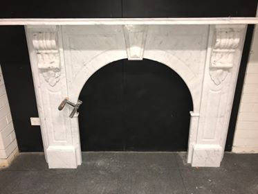 Victorian style antique arched fireplace made of Italian white Carrara