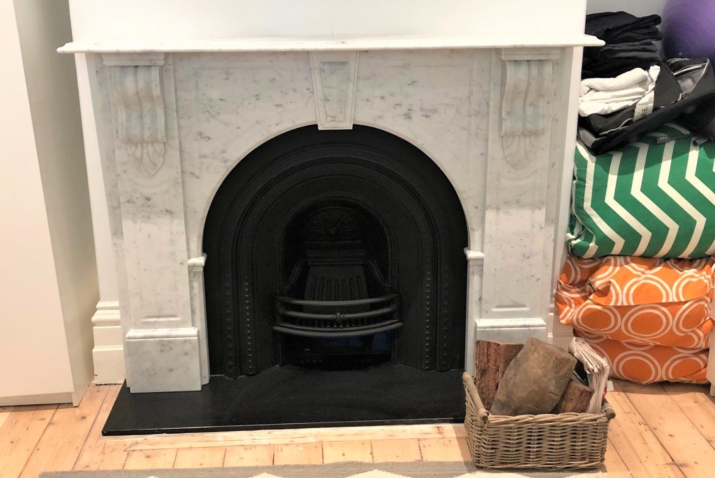 Victorian style arched fireplace made of Italian white Carrara